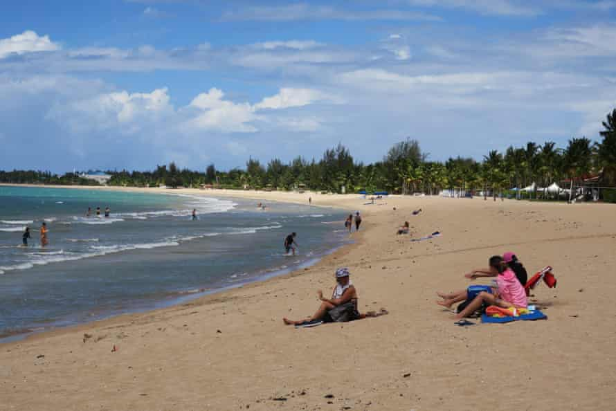 People enjoy Pine Grove beach in Isla Verde, Puerto Rico.