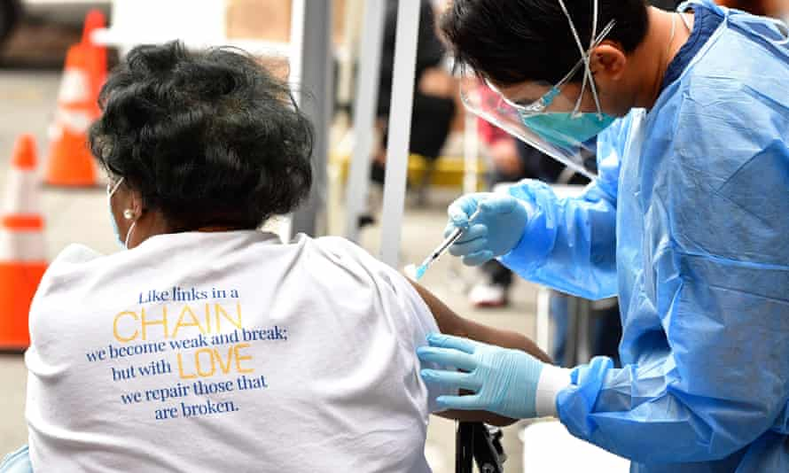 Registered nurse Angelo Bautista administers the Moderna Covid-19 vaccine in the Skid Row area of Downtown Los Angeles.