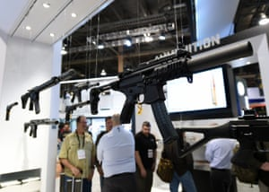 Firearms appear to levitate above attendees