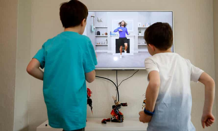 Ben and Isaac Rickett follow PE with Joe, a fitness workout by Joe Wicks that is aimed at children