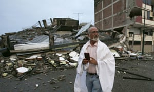 A man walks amid the debris of buildings destroyed by an earthquake in Pedernales, Ecuador