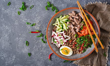 Korean food. Buckwheat noodles with beef, eggs and vegetables.