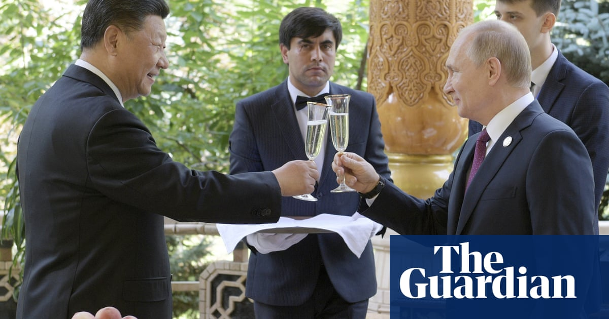 Ice cream and cake: Vladimir Putin hosts birthday party for Xi Jinping – video