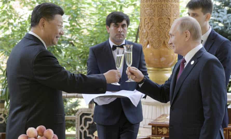 Putin, right, with China's president, Xi Jinping, in Tajikistan in June.