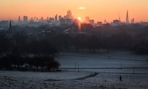 The sun rises over a snowy Primrose Hill, north-west London.