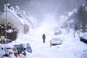 Thick snow covers a street in Tomintoul, Scotland as further cold weather is forecast to arrive from Russia.