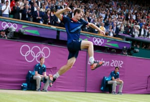 Andy Murray leaping in the air on the tennis court when he won gold at the 2012 Olympics, with two umpires and the crowd behind