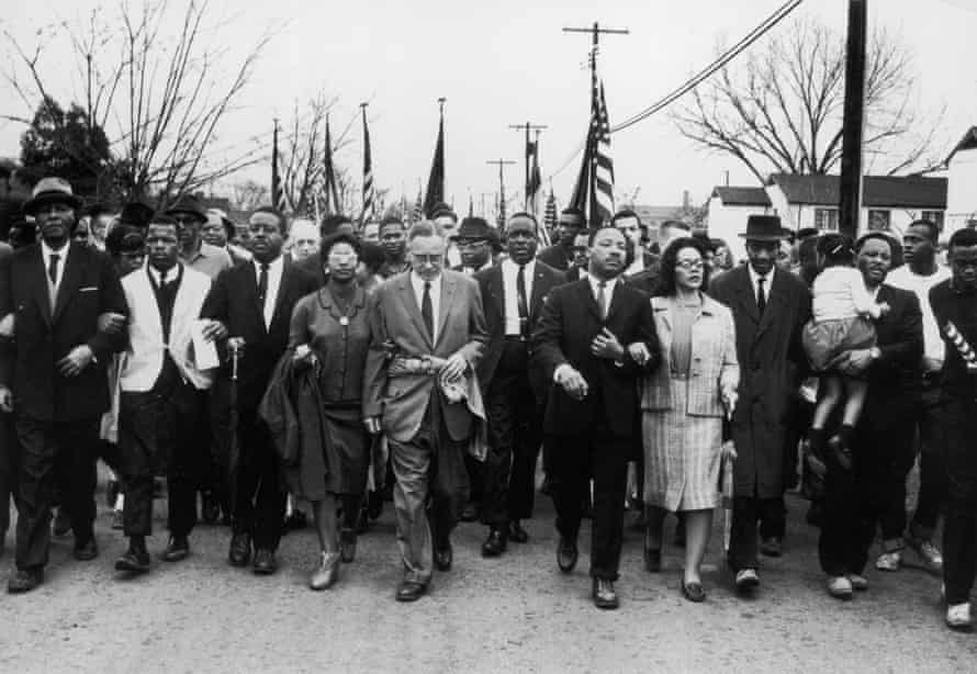 American civil rights campaigner Martin Luther King (1929 - 1968) and his wife Coretta Scott King lead a black voting rights march from Selma, Alabama, to the state capital in Montgomery.