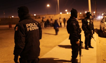 Mexican police investigate a violent incident in Juarez.