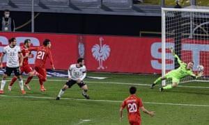 Eljif Elmas of North Macedonia (no 21) scores his team's second goal past goalkeeper Marc-Andre ter Stegen of Germany.