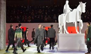 Models walk the runway at the Prada autumn/winter men's fashion show in Milan.
