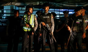 Armed police in the Mingalar Taung Nyunt Muslim neighbourhood in Yangon after clashes between Muslim residents and nationalists