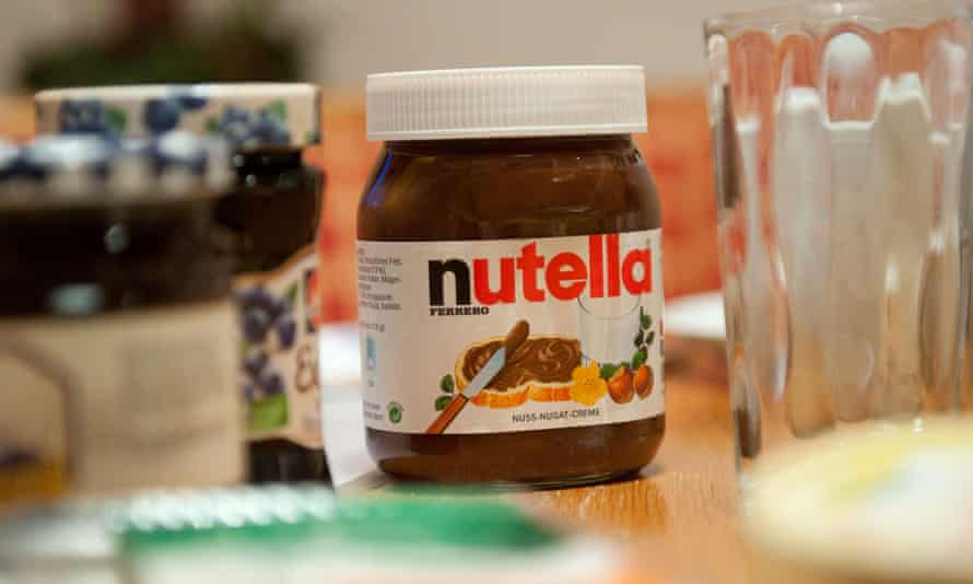 A pot of Nutella on a breakfast table