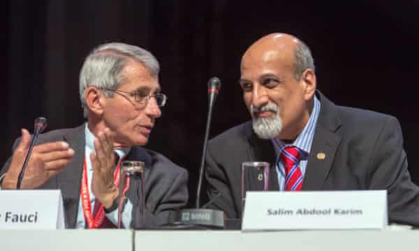 Salim Abdool Karim speaks to Anthony Fauci during the second day of the 21st International Aids conference in Durban in July 2016.