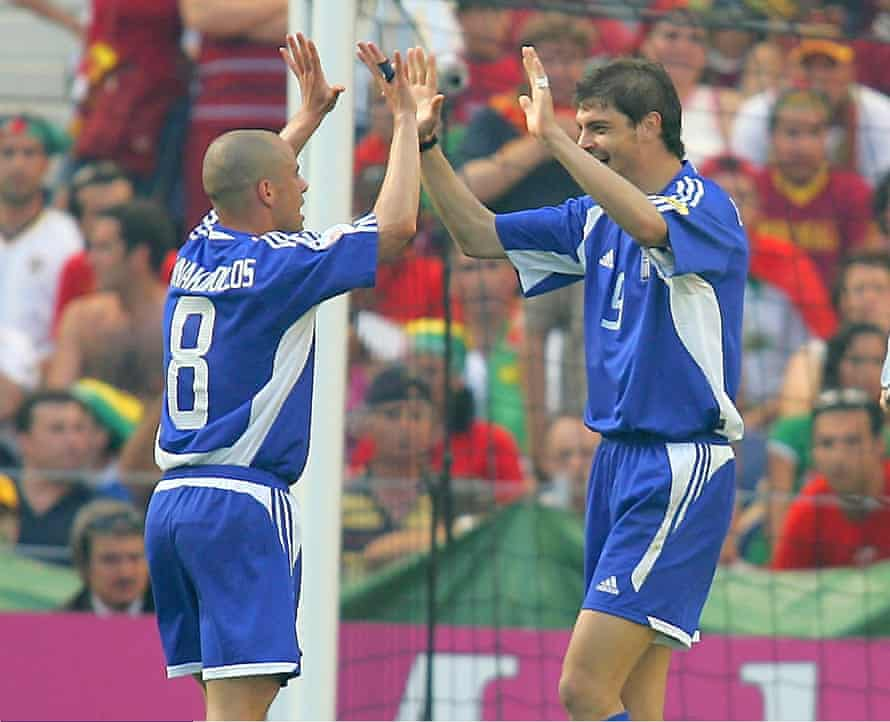 Stylianos Giannakopoulos celebrates with Angelos Charisteas after scoring against Portugal.