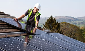 Photovoltaic panels are fitted to the roof of a house in Wales