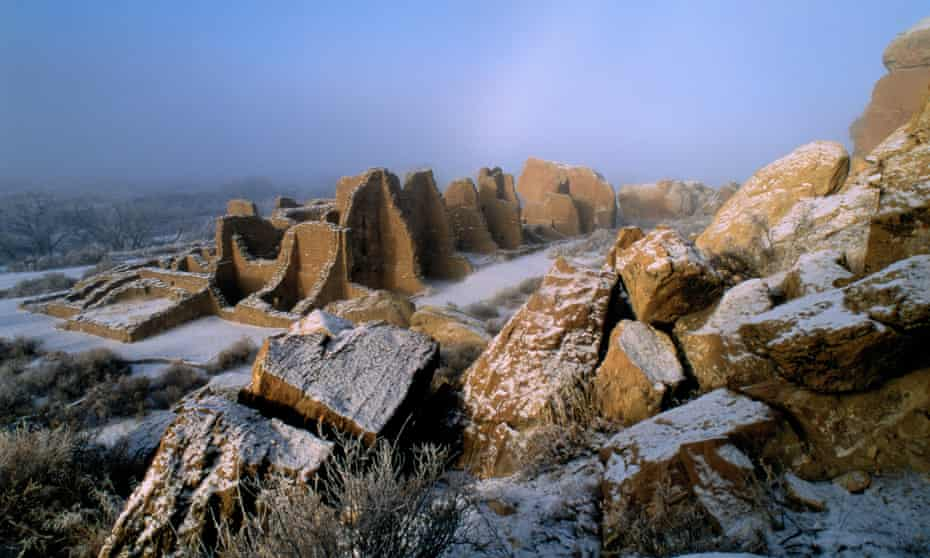 Ruins of ancient masonry walls of a large, multi-room house built by ancestral puebloans in New Mexico, USA