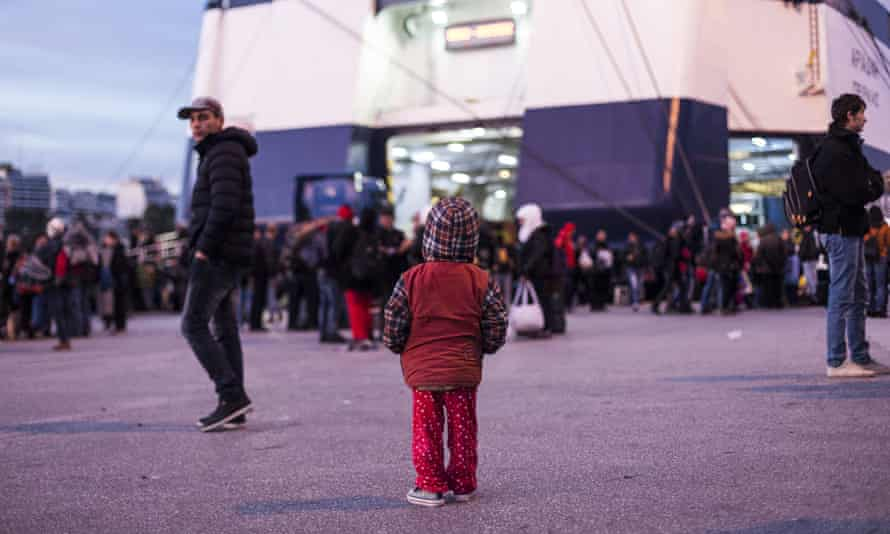 A child waits in front of the ferry in the Greek port of Piraeus, a busy hub for refugees seeking European entry.
