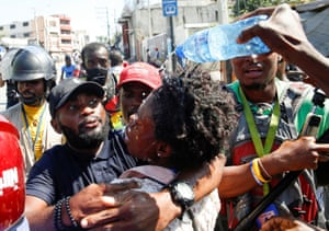 Port-au-Prince, Haiti. Journalists help a colleague who fainted after police threw tear gas during a protest against the president, Jovenel Moïse