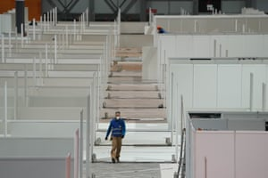 Workers install a field hospital for coronavirus patients in Madrid, Spain, on 21 March, in a handout photo.