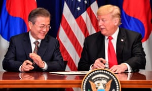 Donald Trump signs a bilateral trade deal with the South Korean president, Moon Jae-in, in New York.