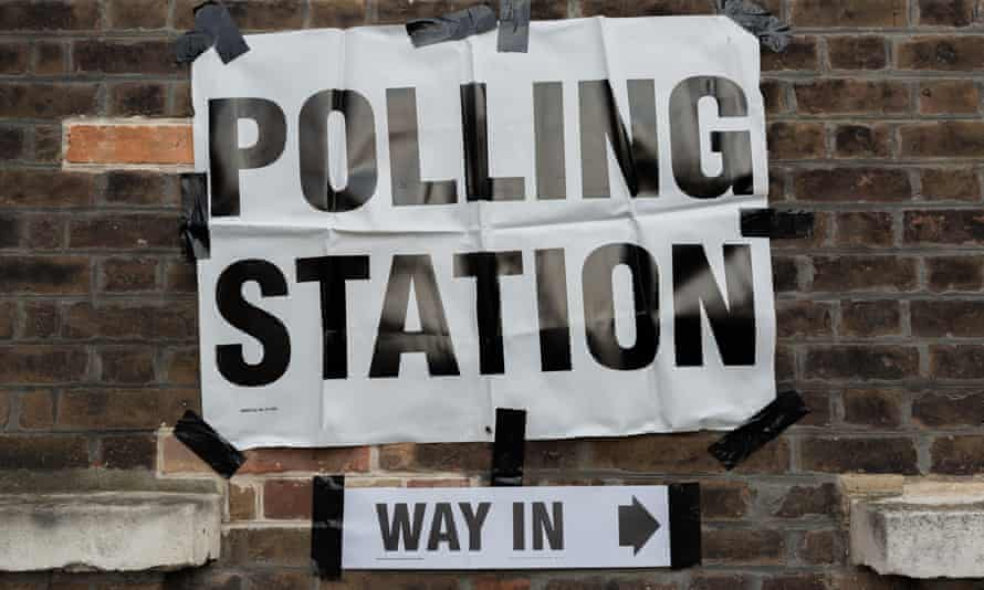 Polling station sign taped to wall in London