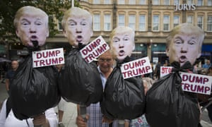 Protesters hold anti-Donald Trump signs during a protest in Queen Street, Cardiff.