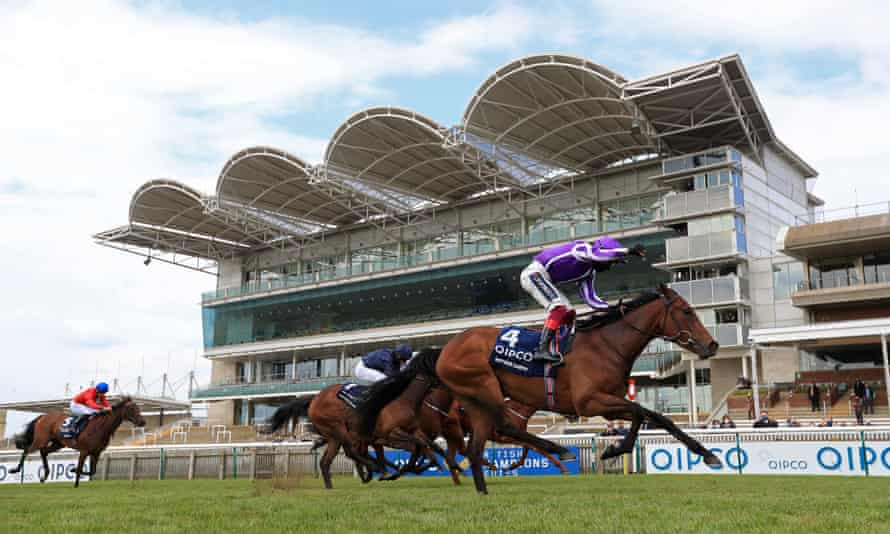 Mother Earth crosses the finish line at Newmarket.