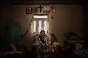 Man sitting in a darkened room