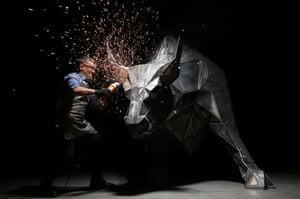 Ridvan Sevim, a metalworker in Bursa, Turkey, puts the finishing touches to a statue of a bull made from 1,035 triangles