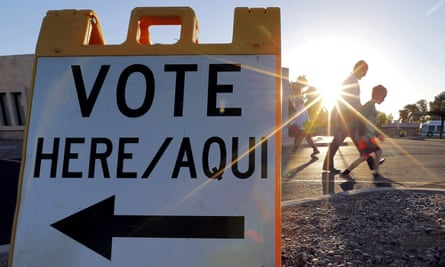 Voters come and go near a polling station at sunrise in Arizona's presidential primary election on 22 March 2016 in Phoenix.