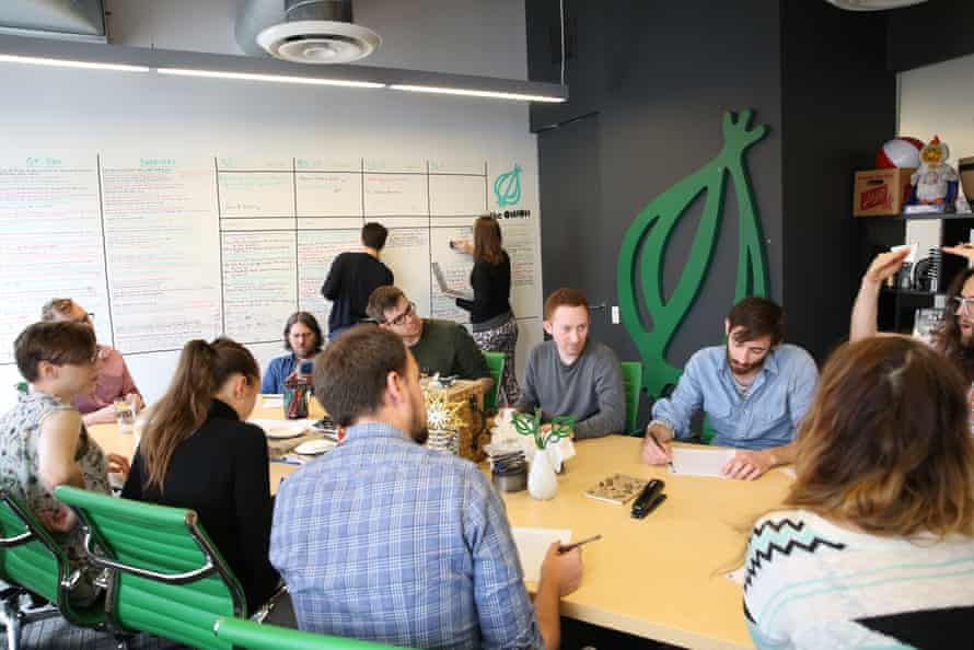 Staff of news satire site the Onion at work.