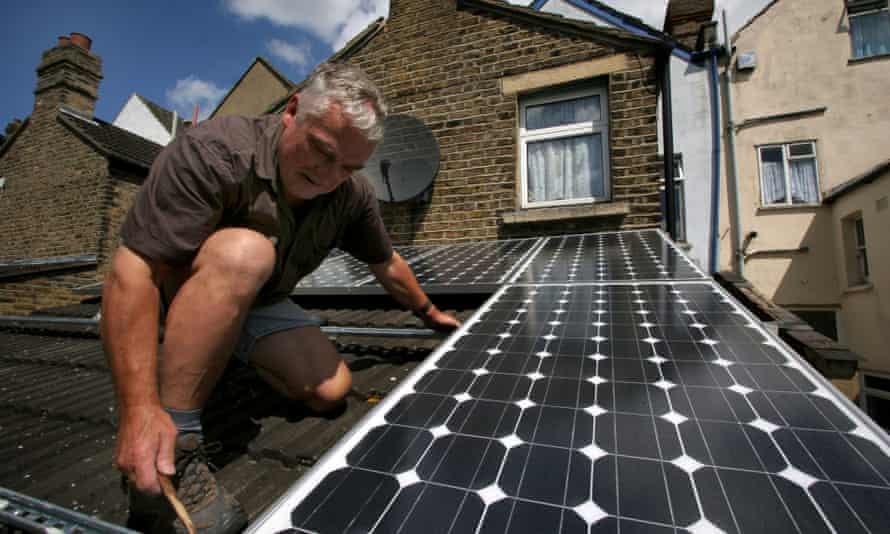 Solar panels being installed on the roof of a house in south-east London.