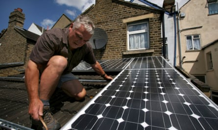 Solar panels being installed on the roof of a house in South East London.
