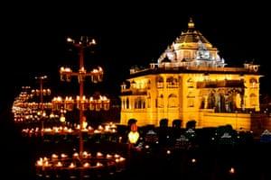 The Akshardham mandir is illuminated with more than 10,000 oil lamps in Gandhinagar, India