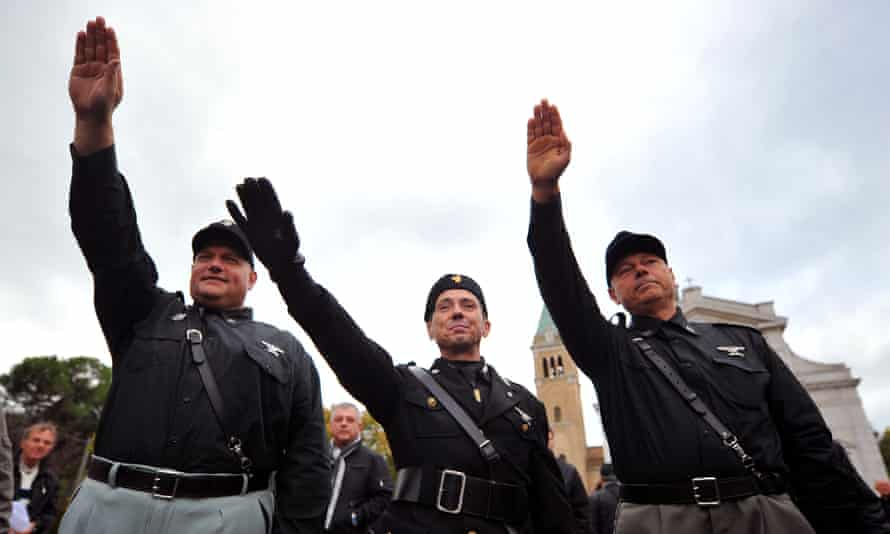 Far-right activists perform fascist salutes during a rally in 2012.