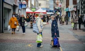 People chat on the high street in Merthyr Tydfil
