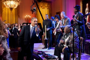 21 February: 'Egged on by BB King, Obama joins in singing Sweet Home Chicago during a concert in the White House's east room. Participants included, from left: Troy 'Trombone Shorty' Andrews, Jeff Beck, Derek Trucks, BB King, and Gary Clark Jr'