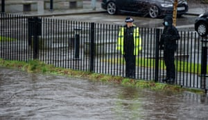 Police watch the rising level of the River Roch in Rochdale