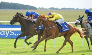 Sea Of Class  and James Doyle (yellow silks) beats Forever Together to win the Irish Oaks