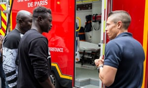 Mamoudou Gassama visiting a fire station in Paris