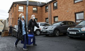 Healthcare workers carry a bag containing Pfizer/BioNTech Covid-19 vaccinations as they arrive at the Abercorn House care home in Hamilton, Scotland.