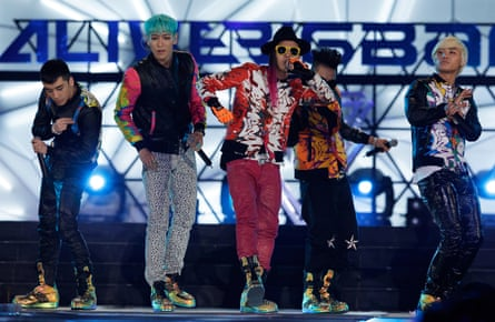 Seungri, left, with his band members in Big Bang.