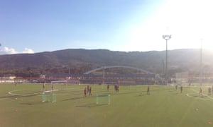 Young players train in front of the Basque hills and famous arch.