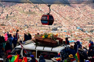 The cortege winds its way high above the city of La Paz.