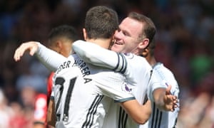 Wayne Rooney celebrates scoring Manchester United's second goal against Bournemouth with Ander Herrera.