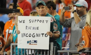 A fan holds a sign in support of Richie Incognito during the Dolphins' bullying scandal