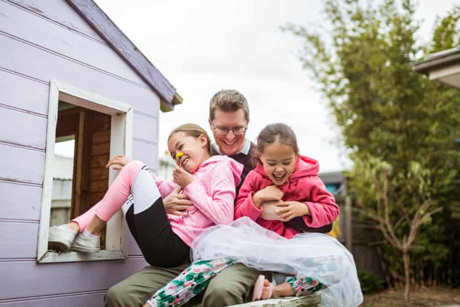 Mike Dwyer and his daughters Penelope and Piper in the backyard of their Mernda home in Melbourne's outer north