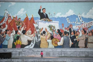 A child stands in front of a mosaic near the Kim Il-sung stadium in Pyongyang
