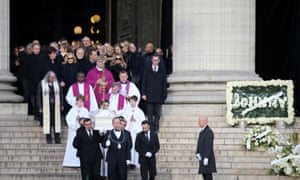 Pallbearers carry the coffin of Johnny Hallyday from La Madeleine church.